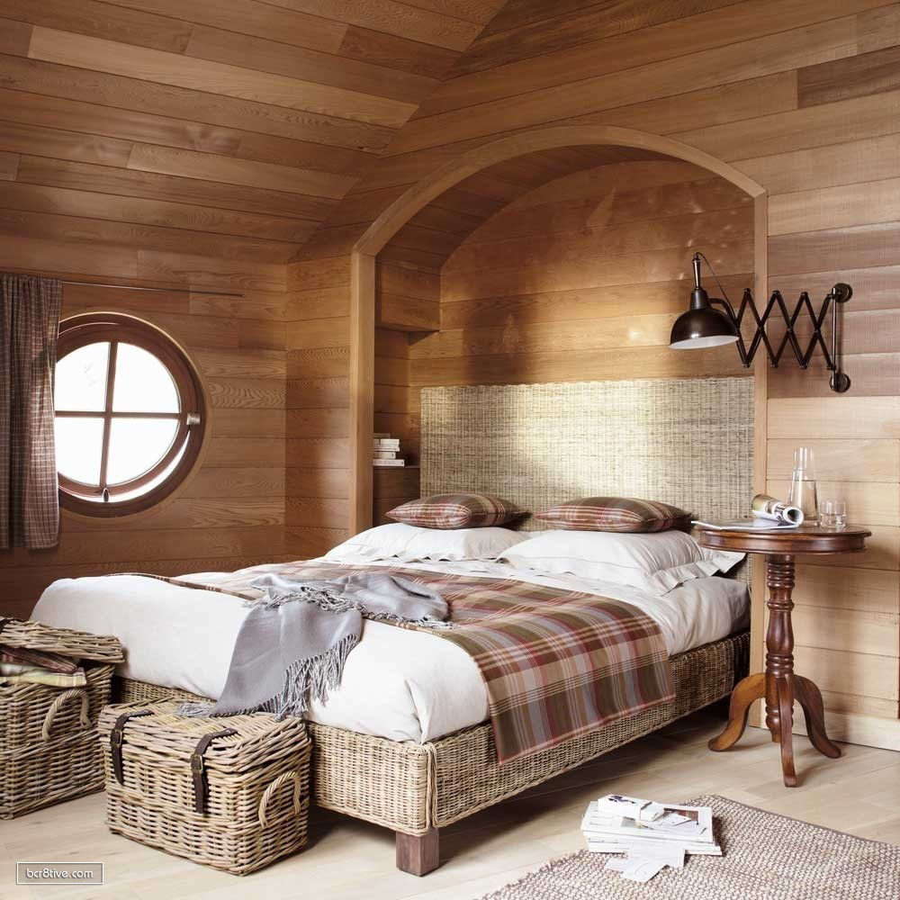 Vaulted Ceiling Bedroom Decorated in Woods & Rattan Furnishing