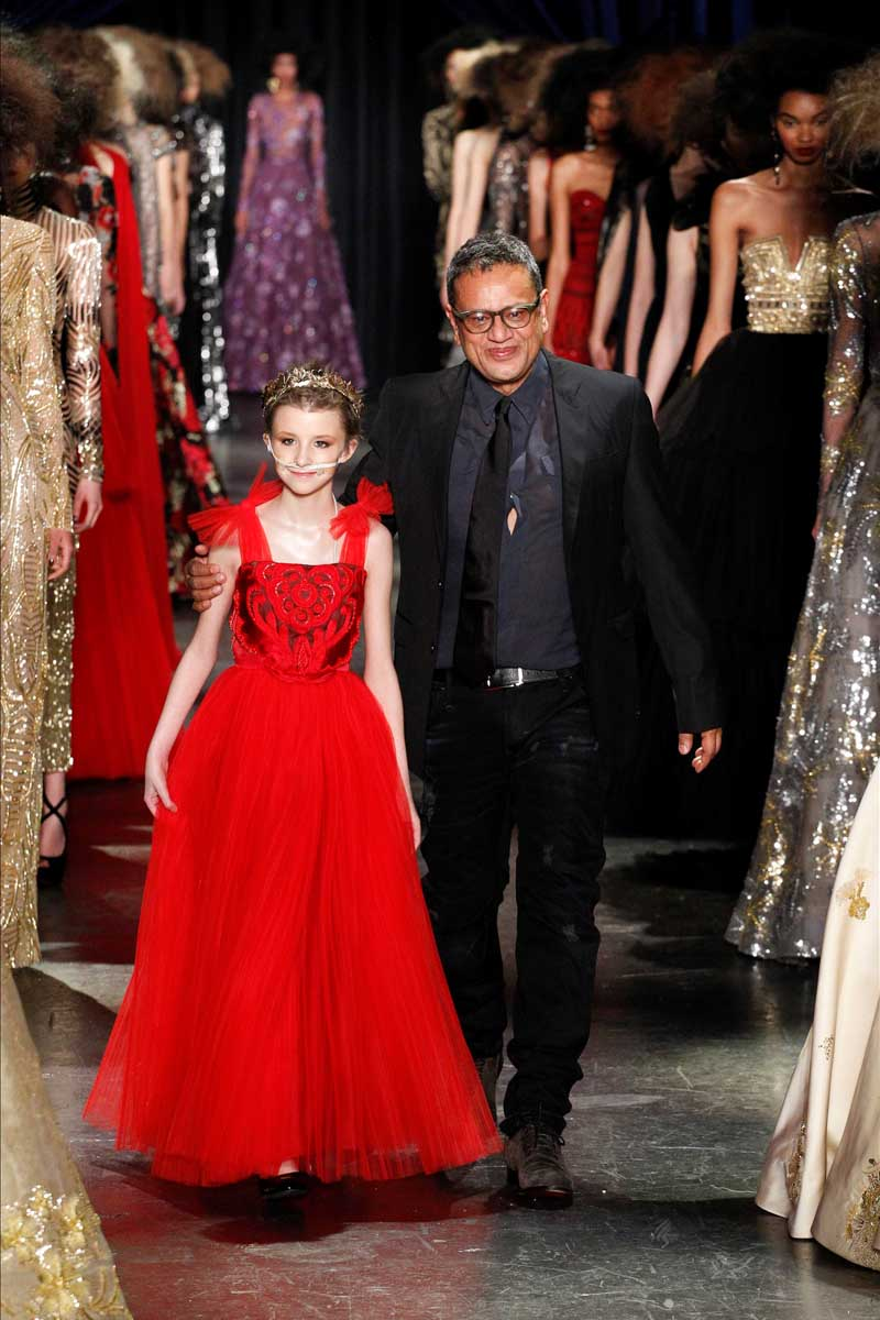 Naeem Khan and Trinity Faith Moran walk the Runway of the Fall 2016 Collection held at New York Fashion Week