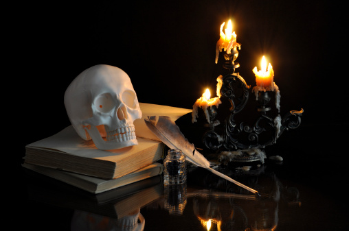 Still life with skull, books and melting candles